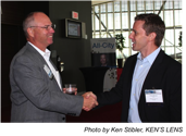 Art Saxby, Principle of Chief Outsiders shaking hands.